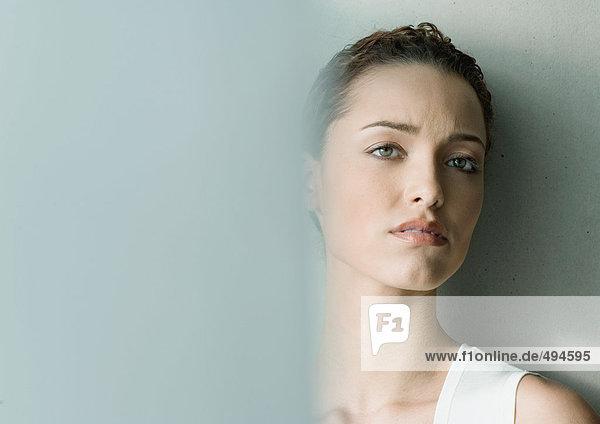 Woman furrowing brow