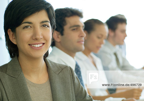 Business colleagues having meeting  focus on woman in foreground