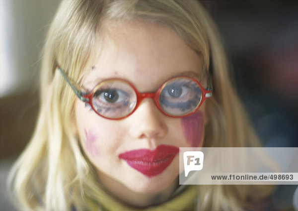 Girl wearing make-up and glasses