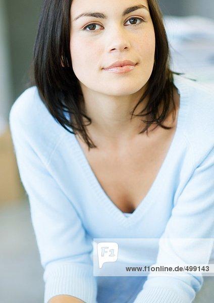 Woman wearing v-neck sweater  portrait