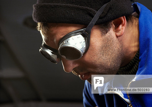 Man wearing protective glasses  close-up