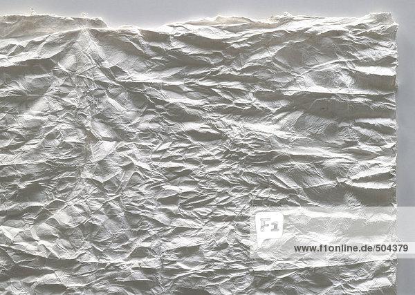 Blatt zerknittertes Papier  Teilansicht  Nahaufnahme