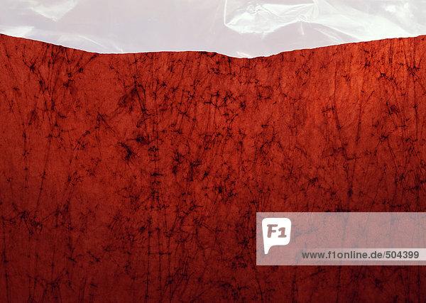 Gemasertes rotes Papier  Nahaufnahme