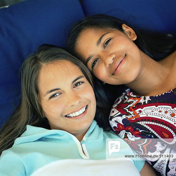 Two girls  looking at camera