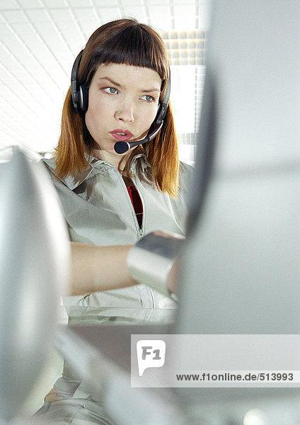 Woman at desk wearing headset