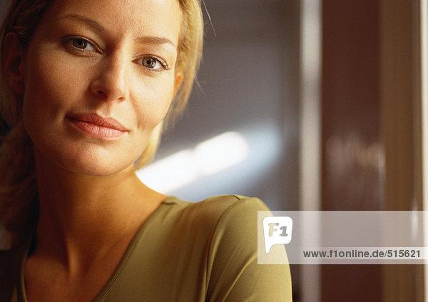 Woman looking at camera  close-up  portrait.