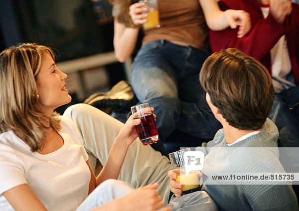 Young people drinking together
