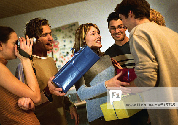 Group of people exchanging presents