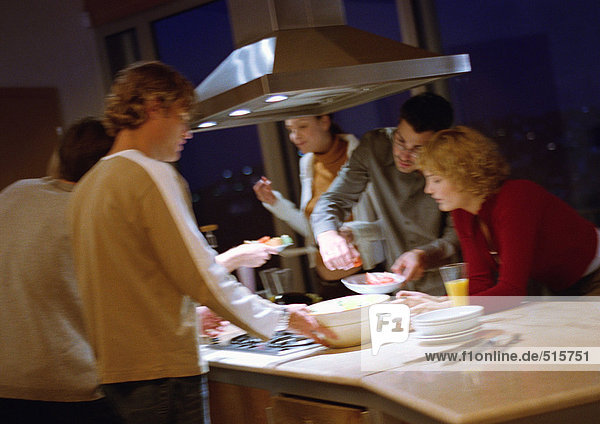 People cooking together in kitchen