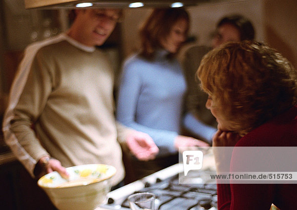 People together in kitchen