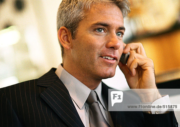 Businessman talking on cell phone  head and shoulders