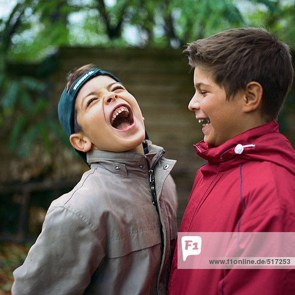 Two boys laughing outside