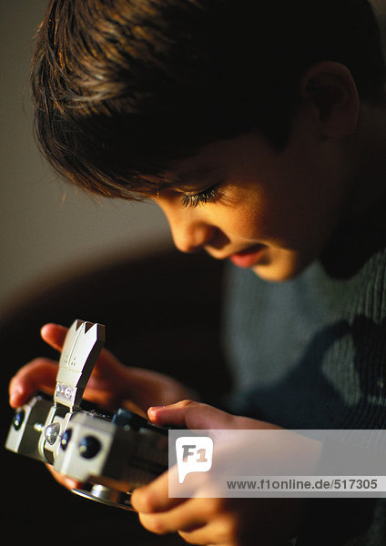 Young boy playing with video game