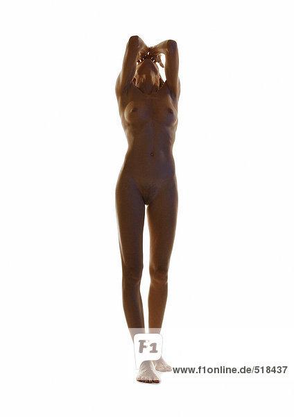 Nackte Frau stehend mit Kopf zurück und Händen auf dem Gesicht  hinterleuchtet