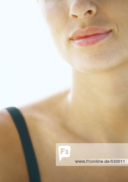 Woman's lower face and neck  close-up mouth