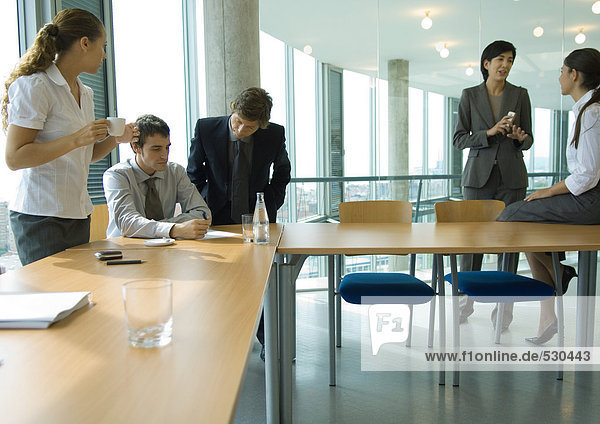 Business associates talking in conference room