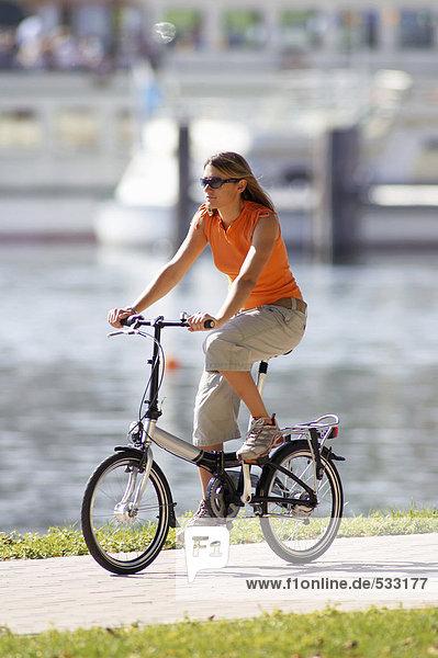 Germany  Bavaria  couple riding bicycle