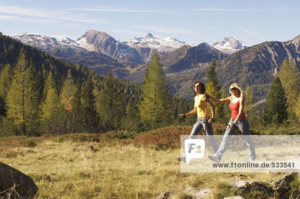 Two women in mountain  Nordic walking