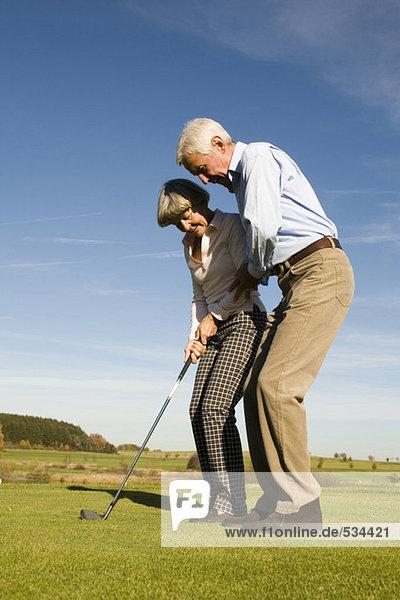 Germany  Bavaria  senior couple playing golf