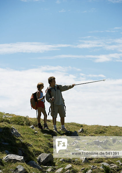Hikers  man pointing with walking stick