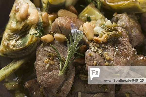 Lamb with artichokes  herbs and pine nuts