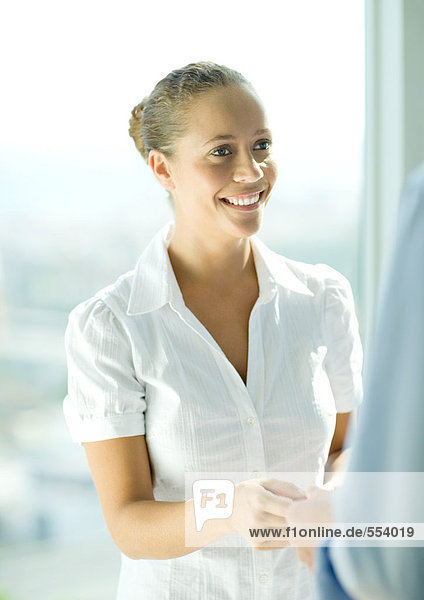 Young female professional smiling