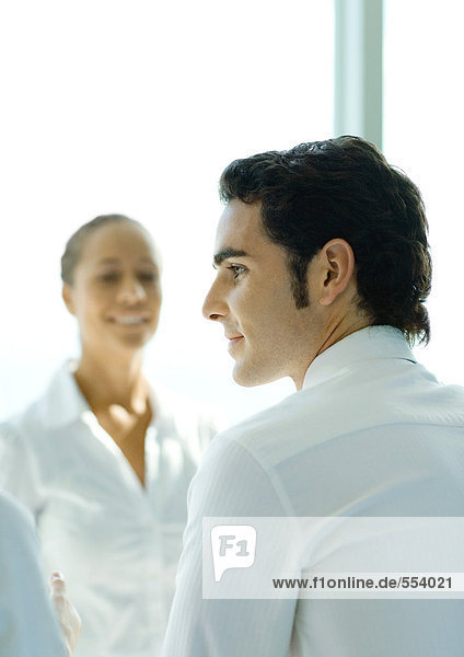 Two young professionals  focus on man in foreground