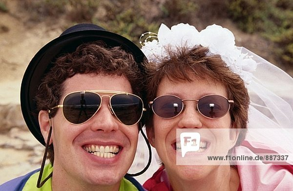 Funny portrait of bride and groom