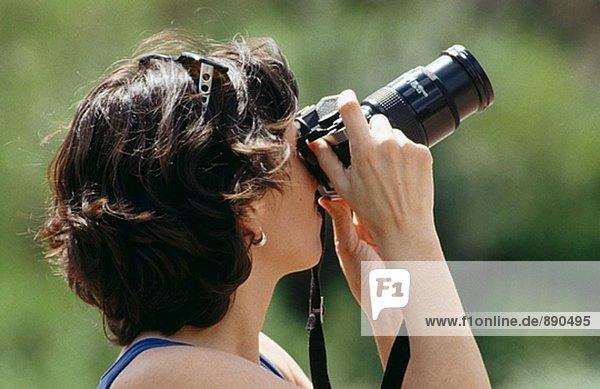Weibliche Fotograf