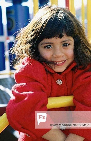 Girl on playground bars