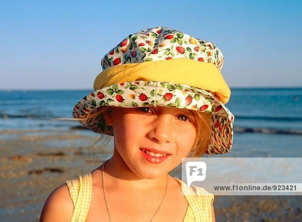 Child in yellow hat