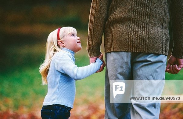 Daughter looks up to dad