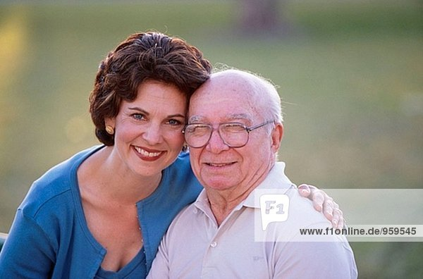 Portrait of senior and his daughter