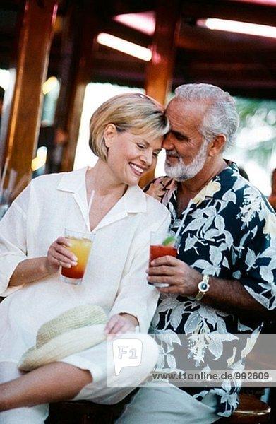mature couple in a Tiki bar