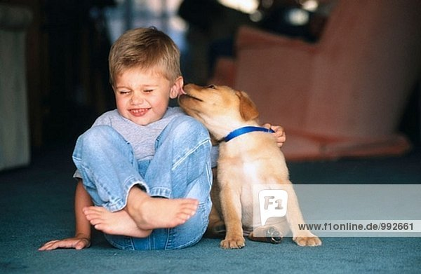 kid with his loving puppy