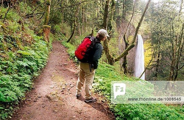 Hiker and Latourell Falls. Columbia River Gorge. Oregon. USA.