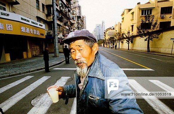 Beggar  street scene in the old town. Shanghai. China