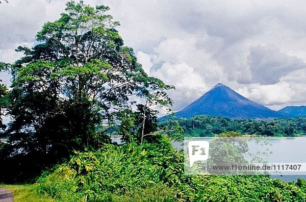 Volcano and lake  Arenal Volcano National Park. Costa Rica