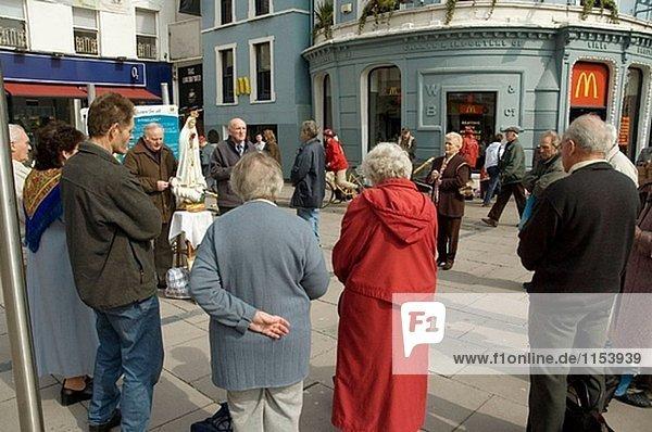 People praying in the street. Cork. Ireland.