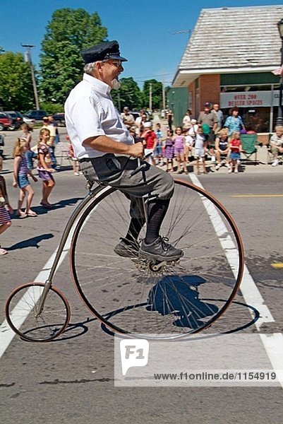 High wheeler vintage historic bicycle at Independence Day parade  Lexington. Michigan  USA