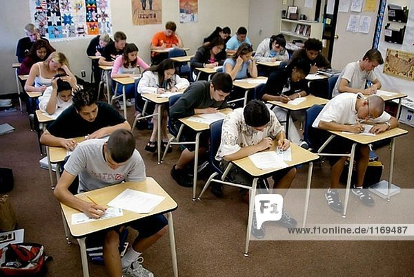 High school students take a standardized multiple-choice test in English class at Capistrano Valley High School in Mission Viejo  CA. Note use of pencils on cards designed for computer scoring