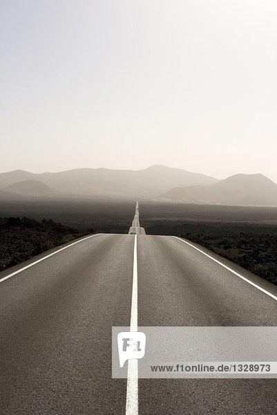 Spain  Lanzarote  empty road through landscape