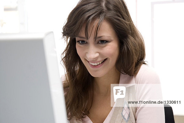 Young woman working in office  smiling  close-up