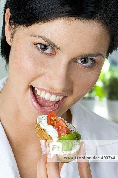 woman with sandwich having breakfast