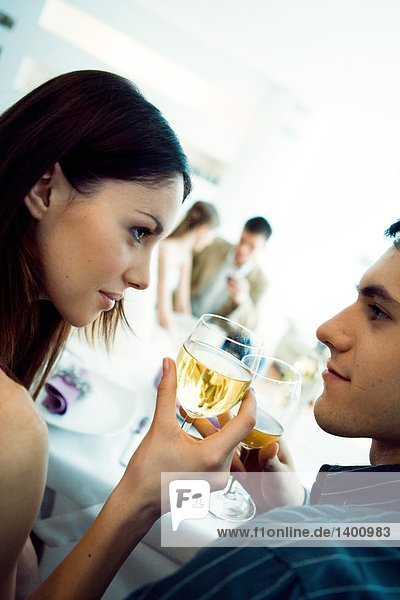 couple drinking white wine on a party