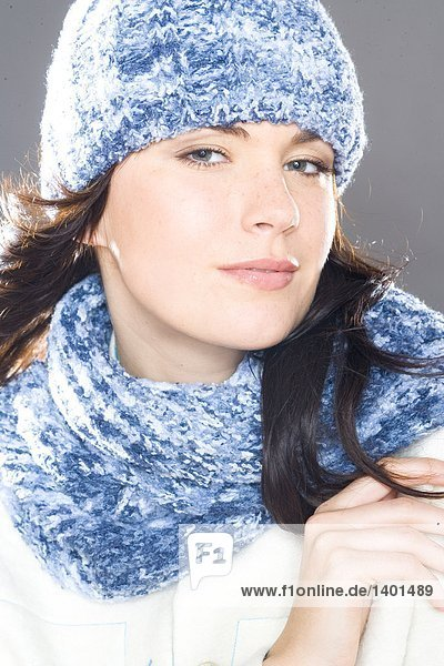 portrait of young woman in winter hat