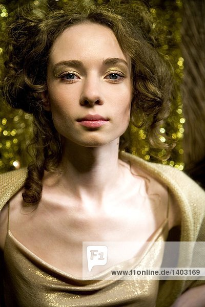 portrait of a woman in golden makeup