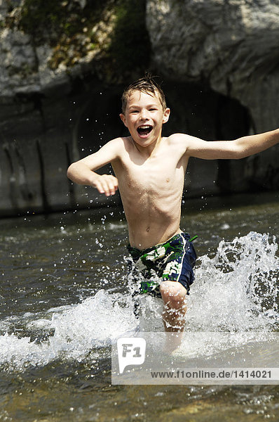 Boy running in river
