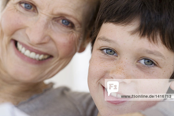 Senior woman and little boy smiling for the camera  indoors