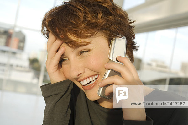 Portrait of a smiling woman phoning